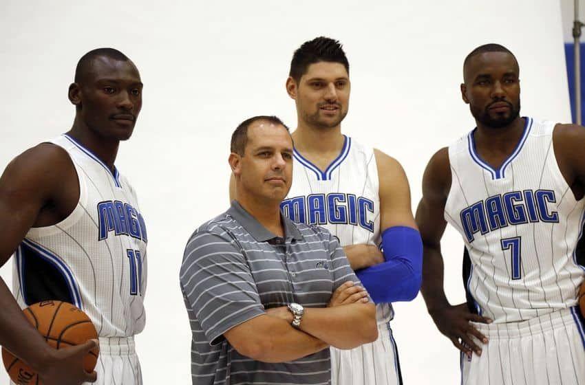 Orlando Magic head coach Frank Vogel, center Bismack Biyombo , center Nikola Vucevic and forward Serge Ibaka pose for a photo during media day at Amway Center.
